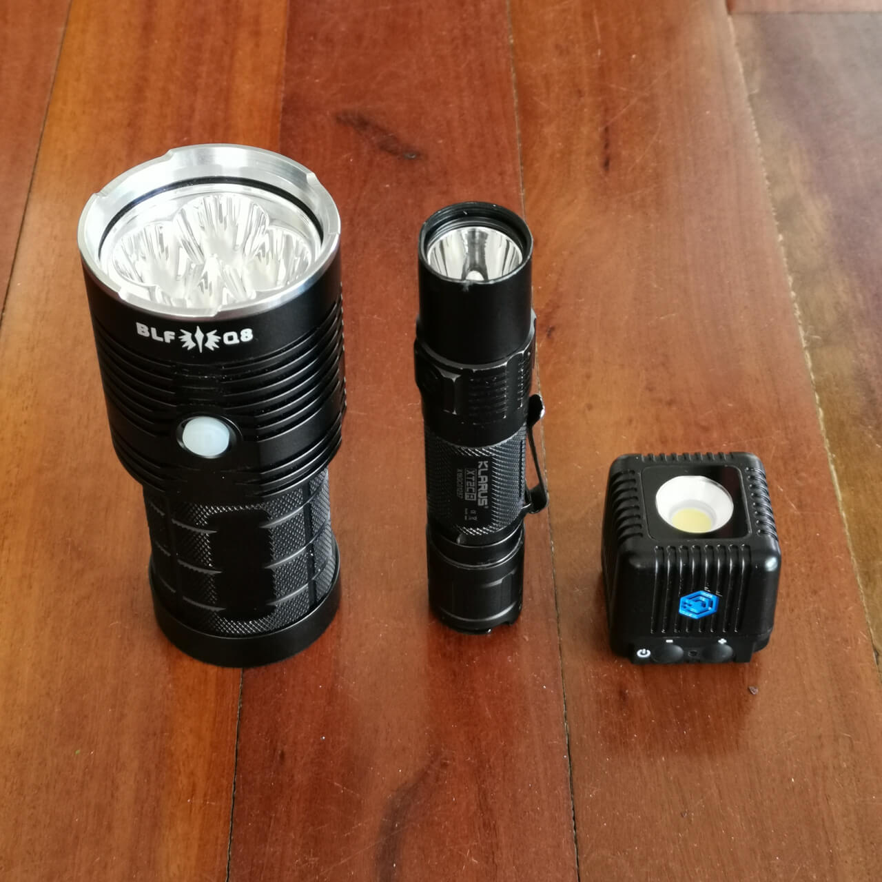 LumeCube 2.0 size compared to a 5,000lm Thorfire Q8 and 1,600lm Klarus XT2CR